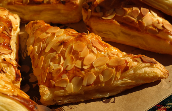 Almond-covered turnover pastries
